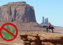 A no marijuana logo superimposed on an image of a sheriff on a horse next to a cliff