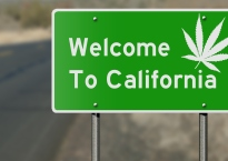 Highway sign as reference to California's laws regarding the use of marijuana.
